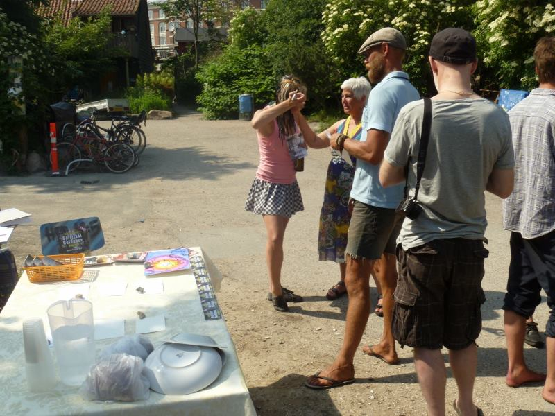 Kim using prophetic cards to witness to people in Christiania, Copenhagen.