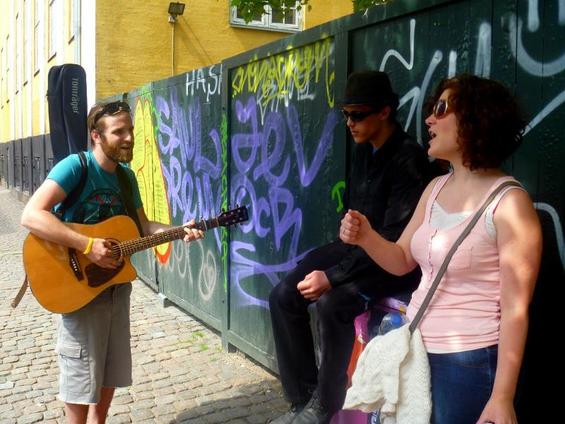 Thilo and Bre singing and witnessing to a young guy on the street.