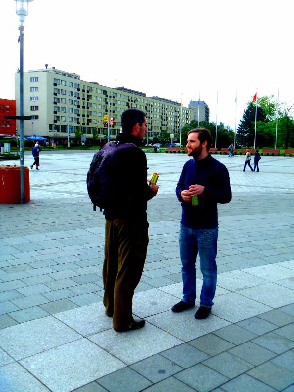 Thilo witnessing to someone on the street.